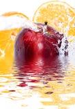 Apple and orange splash Stock Photography