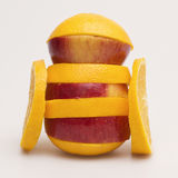 Apple and orange. Stacked together on a white background Stock Photos
