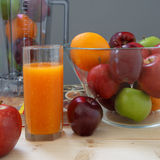 Apple and Orange. On the table Royalty Free Stock Photo