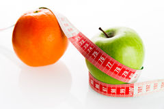 Apple and orange with tailor s ruler. Apple  and orange with tailor s ruler. Fruit healthy vitamin diet Stock Image