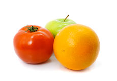 Apple orange and tomato fruits Royalty Free Stock Images