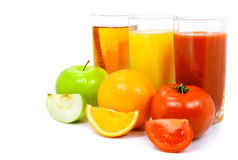 Apple orange and tomato fruits with juice in glass Royalty Free Stock Photo