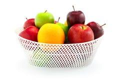 Apple and Orange. On the white background Royalty Free Stock Photos