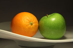 An apple  and an orange Stock Photo