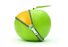 Apple orange zip. Green apple with an orange underneath an open zip Stock Images