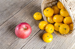 Apple and oranges on the wooden floor Stock Photo
