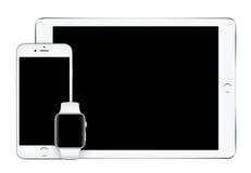 Apple osrebrza iPad Pro iPhone 6S i Jabłczanego zegarka mockup Fotografia Royalty Free