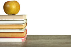 Apple over books. Royalty Free Stock Photos