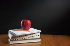 Apple over pile of books Stock Photography