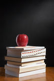 Apple over pile of books Stock Images