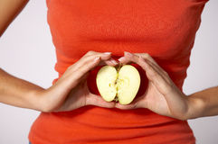 Apple over tummy Royalty Free Stock Photo
