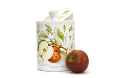 Apple with the painted jar Royalty Free Stock Images