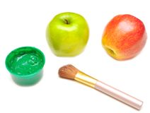 Apple and paints Stock Photography