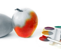 Apple and paints on white royalty free stock photography