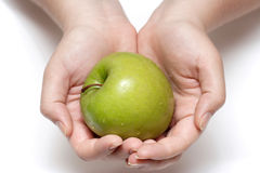 Apple in palms Royalty Free Stock Photos