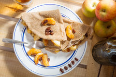 Apple pancakes. With a bottle of cider Stock Image