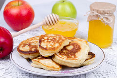 Apple pancakes with milk and honey. Stock Photography