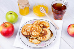 Apple pancakes with milk and honey. Royalty Free Stock Images