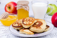 Apple pancakes with milk and honey. Royalty Free Stock Photo