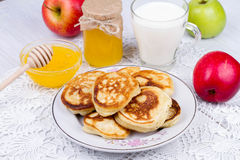 Apple pancakes with milk and honey. Stock Photo