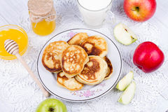 Apple pancakes with milk and honey. Royalty Free Stock Photography