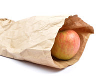 Apple in paper bag Royalty Free Stock Photo
