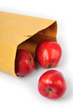 Apple in paper bag Stock Photography