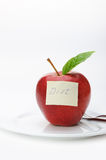 Apple with a paper note Royalty Free Stock Image