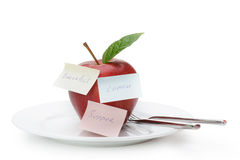 Apple with paper notes Royalty Free Stock Images