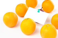 Apple with paper notes inside group of orange. Isolated white background Stock Photo