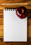 Apple,paper and pencil Stock Image