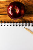 Apple,paper and pencil Royalty Free Stock Photos