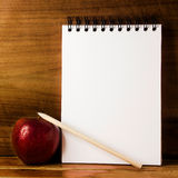 Apple,paper and pencil Stock Photos