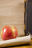 Apple and paper scroll Royalty Free Stock Image