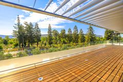 Apple Park new HQ. Cupertino, CA, United States - August 12, 2018: terrace of Apple Park Visitor Center overlooking the new futuristic Apple HQ with Campus royalty free stock photography