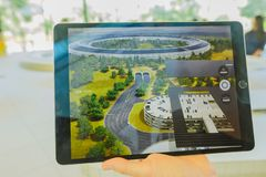 Apple Park new offices. Cupertino, CA, United States - August 12, 2018: closeup of iPad with virtual reality program showing the new Apple Offices and the stock images