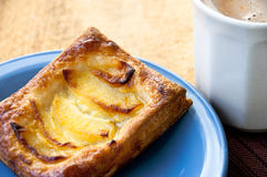 Apple pastry on a blue plate with hot cocoa Royalty Free Stock Photography