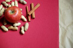 Apple and peanuts Stock Photos