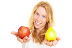 Apple and pear. Blonde woman holding an apple with a pear stock photos
