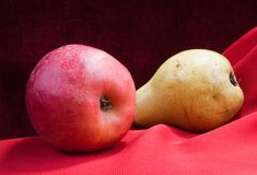 Apple and pear. Still life with red apples and yellow pear Royalty Free Stock Images