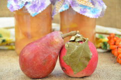 Apple and pear. Bright delicious fruits on background jars with jam of apples and pears Stock Photo