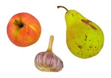 Apple, pear, garlic Stock Photos