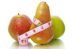 Apple and pear with measuring tape Stock Image