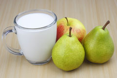 Apple,pear and milk Stock Images