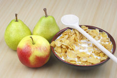 Apple,pear ,milk and cornflakes Royalty Free Stock Images