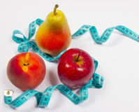 Apple, pear, peach and tape measure, diet concept Stock Images