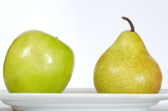 Apple pear and plate royalty free stock image