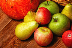 Apple, pear, pumpkin. Harvest of ripe fruits and vegetables: apples, pears and pumpkin Royalty Free Stock Photo
