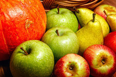 Apple, pear, pumpkin. Harvest of ripe fruits and vegetables: apples, pears and pumpkin Royalty Free Stock Photos