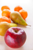 Apple, pear and tangerines Royalty Free Stock Photo